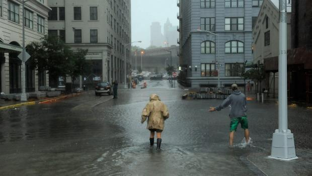 Nancy Zakhary and Eddie Lima of Brooklyn wade through flood waters filling the intersection of Main St and Plymouth St in Dumbo Brooklyn as Hurricane Irene reaches the New York City Area on August 28,