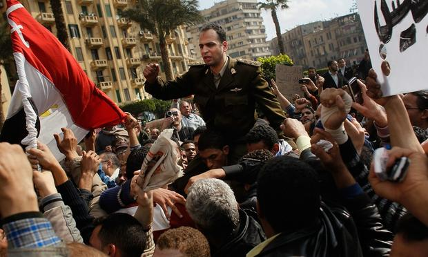 An Egyptian Army officer sympathizing with marchers is carried during an anti-government protest in Tahrir Square January 30, 2011 in Cairo, Egypt.