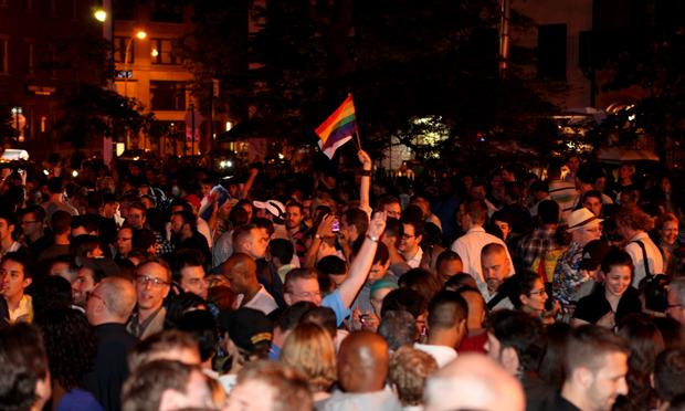 Hundreds gather outside of the Stonewall Inn to celebrate the passage of a same-sex marriage bill.