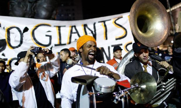 Musician Harold Wilson chants as fans celebrate the Giants World Series win at the Civic Center Plaza November 1, 2010 in San Francisco, California.