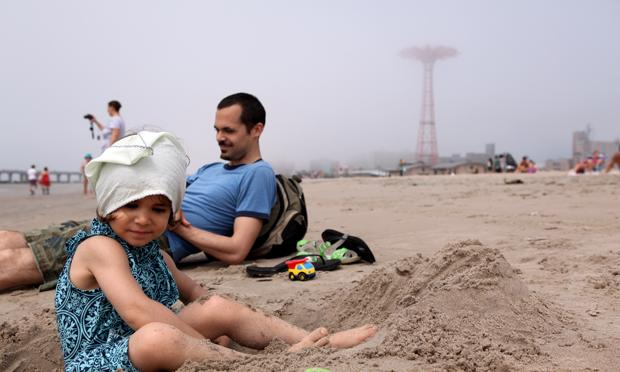 Young girl and her father at the Coney Island beach the Friday before Memorial Day.