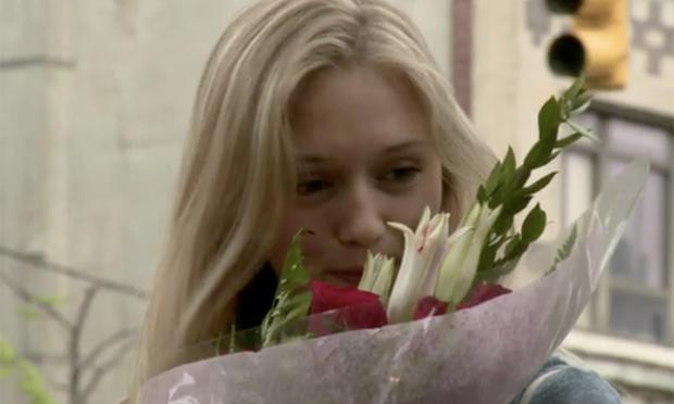 girl smells flowers