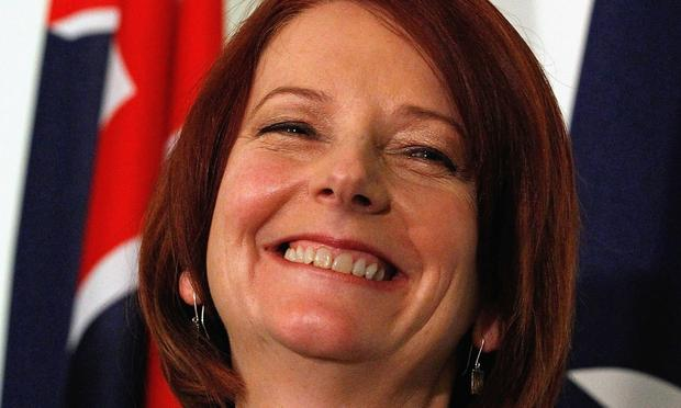 Australian Prime Minister Julia Gillard smiles during a press conference following the Labour leadship spill which saw Gillard call a leadership ballot for the role of Prime Minister at Parliament Hou