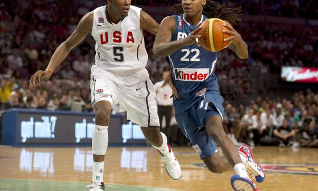 The USA's Kevin Durant and France's Mickael Gelabale during the Global Community Cup basketball exhibition game between France and the USA August 15, 2010 at Madison Square Garden in New York.