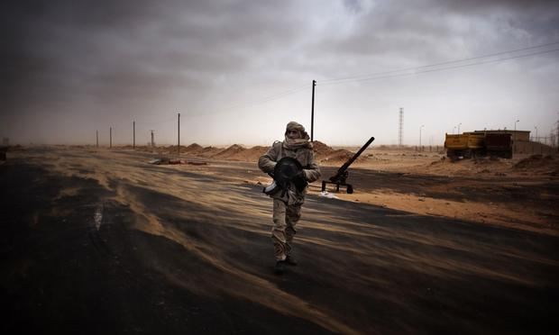A Libyan rebel fighter mans a check point in the stronghold oil town of Ras Lanuf on March 5, 2011 where up to 10 people were killed and more than 20 wounded.