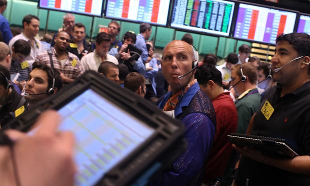 Traders on the floor of the New York Mercantile Exchange on August 4, 2010 in New York City