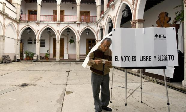 A man leaves the polling booth after casting his vote in Uruapan, Michoacan