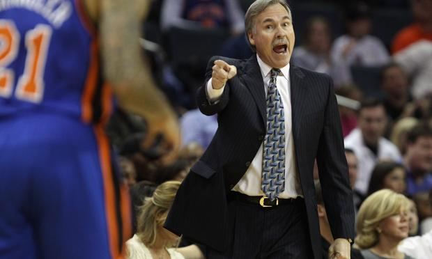 Head coach Mike D'Antoni of the New York Knicks yells to his team against the Charlotte Bobcats during their game at Time Warner Cable Arena on November 24, 2010 in Charlotte, North Carolina