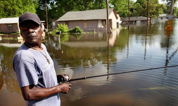William Jefferson fishes in the street near his flooded home in the King's Community neighborhood May 11, 2011 in Vicksburg, Mississippi.