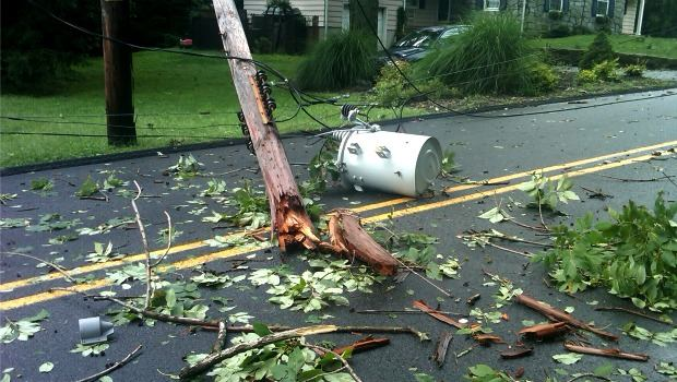 Massive hardwoods came down and snapped power poles and lines on Woodland Avenue in Brookside, NJ.