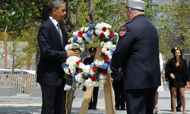 President Barack Obama lays a wreath at the 9/11 Memorial in New York on May 5, 2011.