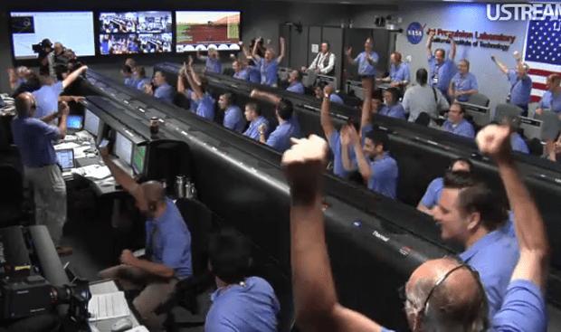 The NASA crew celebrates as the Mars Rover lands.