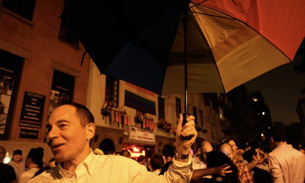 As gay marriage is approved in New York, a street party erupts in front of Stone Wall Inn in the West Village