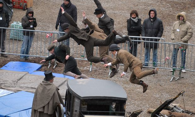 Stuntmen train on the set prior to the shooting of a scene of the 'Sherlock Holmes 2' movie, in front of the cathedral of the French eastern city of Strabourg, on February 3, 2011