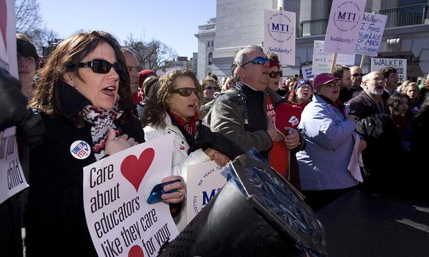Protesters sing the national anthem at the State Capital building February 18, 2011 in Madison, Wisc.