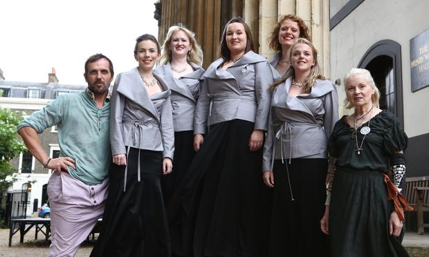 Members of the Monteverdi Choir, clad in their new jackets, pose with the designers Andreas Kronthaler and Vivienne Westwood.