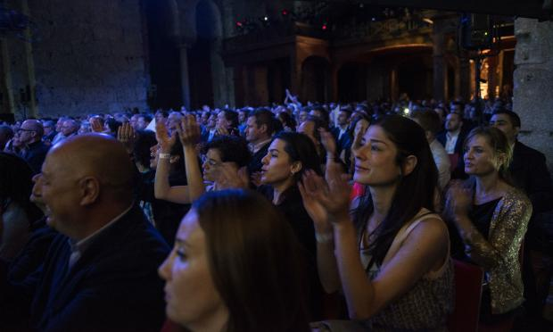An audience awaits an encore at an orchestra concert