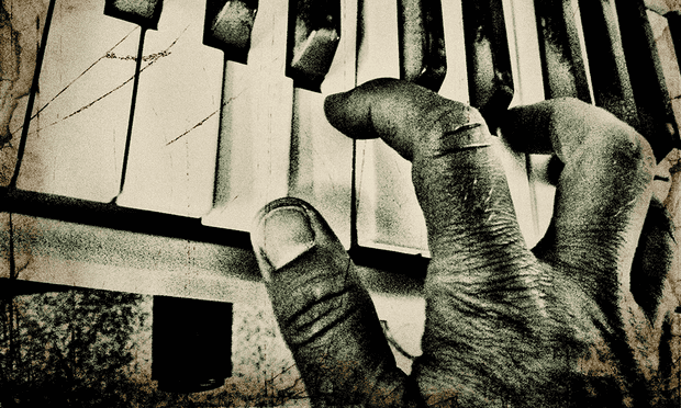 Hand playing the piano