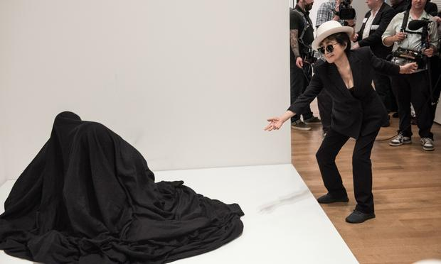 Yoko Ono with a participatory work at MoMA