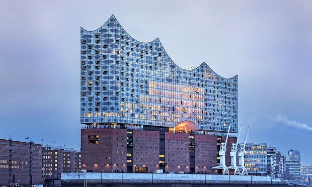 The Elbphilharmonie stands tall above the River Elbe