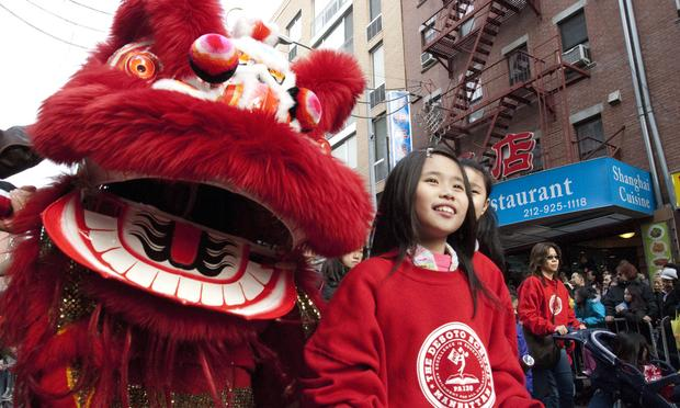 Students from PS130M The Desoto School walk in the 2014 Chinese Lunar New Year Parade
