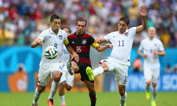 Philipp Lahm of Germany is challenged by Clint Dempsey (L) and Alejandro Bedoya of the U.S. during the 2014 FIFA World Cup Brazil group G match at Arena Pernambuco on June 26, 2014 in Recife, Brazil.