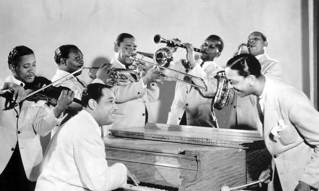 Duke Ellington (seated) and members of his famous Ellington Orchestra
