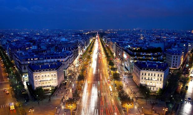 The Champs-Elysées in Paris at night.