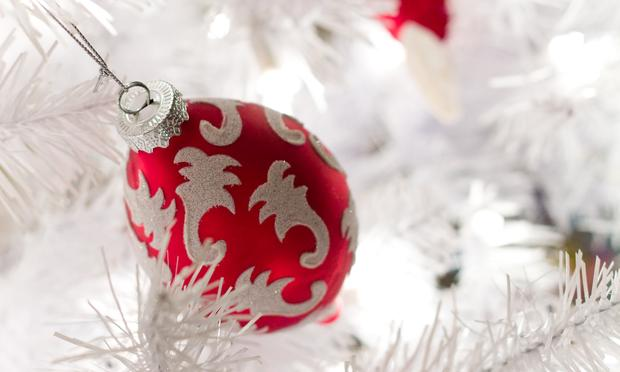 Red and White Ornament on a White Christmas Tree
