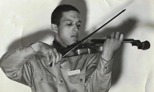 Everett Lee performs the violin in his Tuskeegee Airmen uniform in 1943.