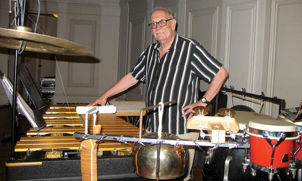 Composer George Crumb amidst instruments