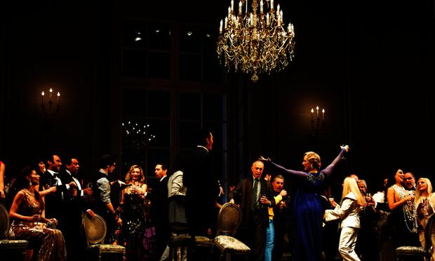Party scene in La Traviata at Teatro alla Scala in Milan, Italy.