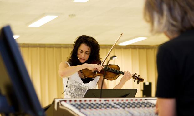 Violinist Monica Germino and sound designer Frank van der Weij in the studio