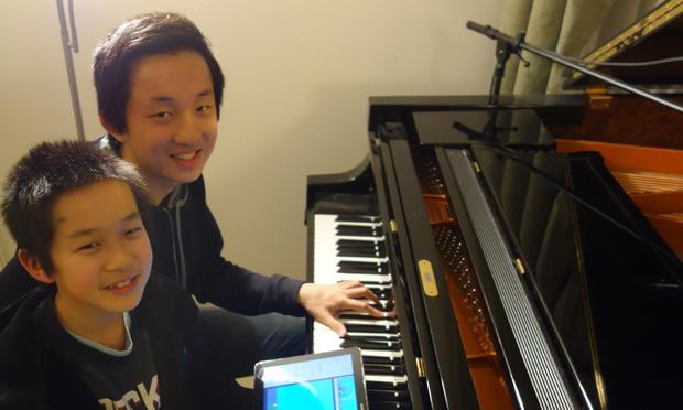 11-year-old William Liu and 16-year-old Charlie Liu, the fraternal duo behind 'Fantasies.'