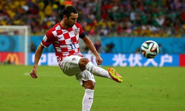 Darijo Srna of Croatia controls the ball during the 2014 FIFA World Cup Brazil Group A match between Croatia and Mexico at Arena Pernambuco on June 23, 2014 in Recife, Brazil.