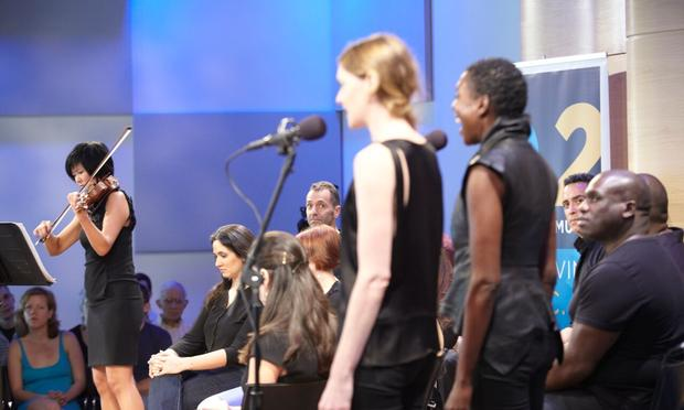 Violinst Jennifer Koh and vocalist Helga Davis with the cast from 'Einstein on the Beach' in The Greene Space