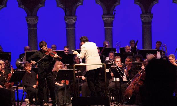 Violinist Joshua Bell performs Sibelius's Violin Concerto with the Orchestra of St. Luke's under the direction of Cristian Macelaru at the Caramoor Festival.