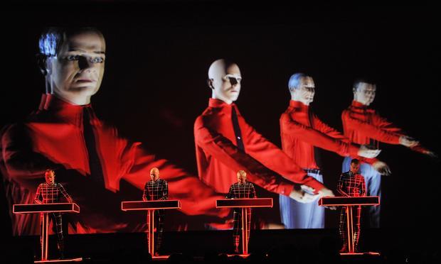 Ralf Hütter, Henning Schmitz, Fritz Hilpert, and Stefan Pfaffe of Kraftwerk perform during the Kraftwerk - Retrospective 1 2 3 4 5 6 7 8, Autobahn (1974) at The Museum of Modern Art on April 10, 2012.