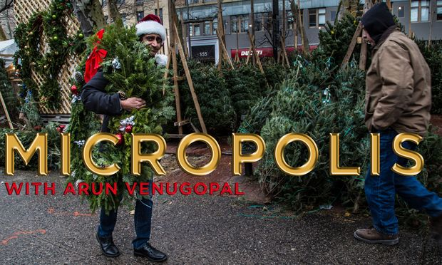 Arun Venugopal of Micropolis carrying a wreath near Soho Christmas Tree Marketplace.