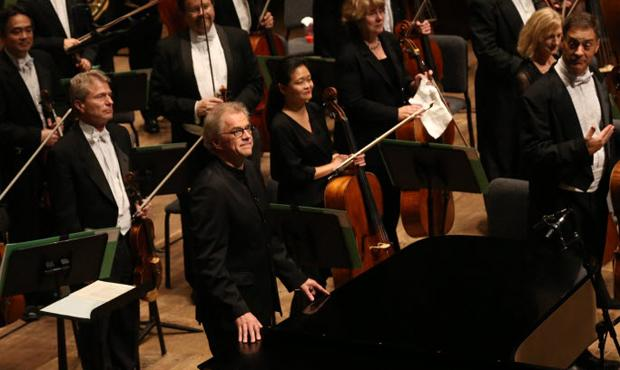 Former music director Osmo Vänskä (center) at his farewell concert with the Minnesota Orchestra at Ted Mann Concert Hall in Minneapolis, Minnesota on October 4, 2013