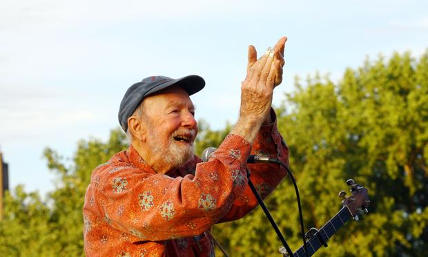 Singer Pete Seeger performs at the 2009 Dorothy and Lillian Gish Prize special outdoor tribute at Hunts Point Riverside Park on Sept. 3, 2009 in New York City.
