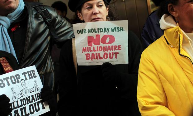 People attend a rally outside of the office of Sen. Charles Schumer (D-NY) to protest an extension of tax breaks for the wealthiest two percent of Americans on December 2, 2010 in New York City.