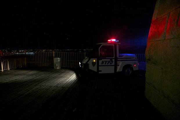 A NYPD vehicle stationed on the Brooklyn Bridge.