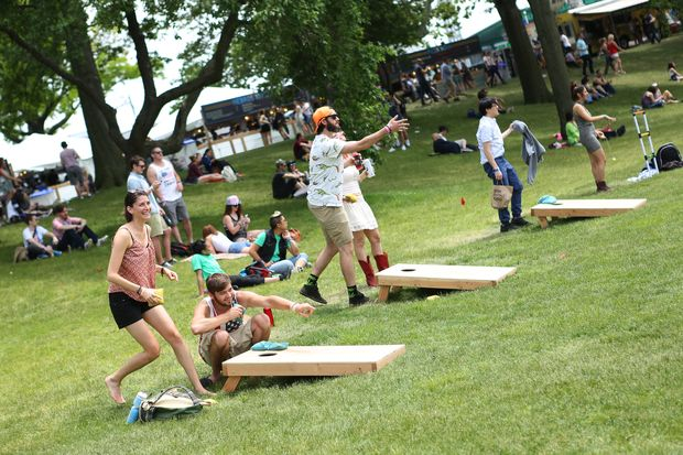 Festival goers playing cornhole early on Saturday afternoon at Governors Ball.