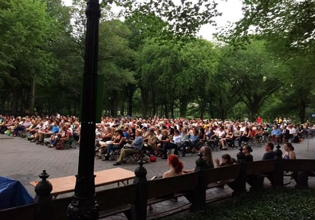 The audience waited through a rain delay for the Knights Concert at the Naumburg Bandshell