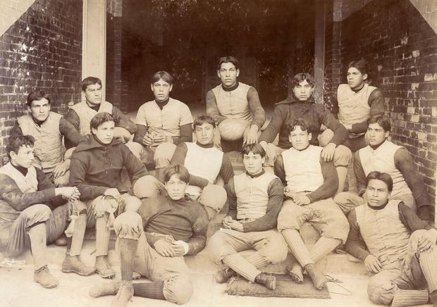 Group photo of 14 members of 1896 football team at Carlisle Indian School