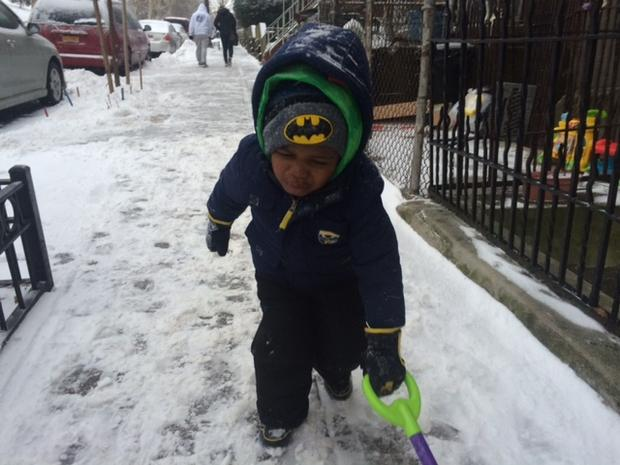 Nalay is working hard shoveling his block in Sunset Park, Brooklyn.