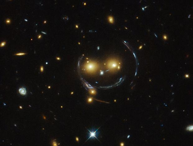 Hubble telescope finds a smiley face in space