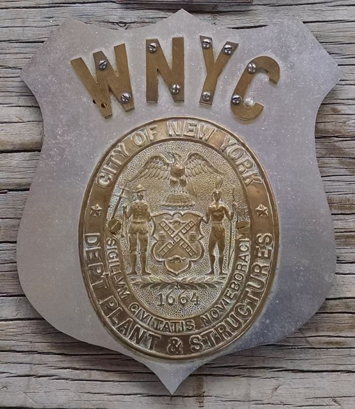 Original car shield used by Isaac Brimberg for offcial WNYC business.