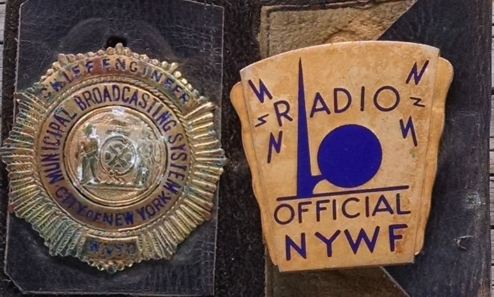 Isaac Brimberg's original WNYC shield and World's Fair badge.